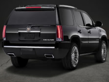 2014-Cadillac-Escalade-Rear-Quarter-1500x1000.jpg