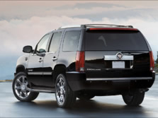 2014-Cadillac-Escalade-Rear-Quarter-2-1500x1000.jpg
