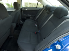 2014-Mitsubishi-Lancer-Sedan-Rear-Interior-3-1500x1000.jpg