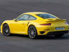 2014-Porsche-911-Turbo-Coupe-Rear-Quarter-2-1500x1000.jpg