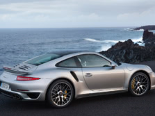 2014-Porsche-911-Turbo-Coupe-Rear-Quarter-3-1500x1000.jpg