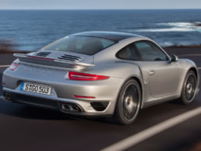 2014-Porsche-911-Turbo-Coupe-Rear-Quarter-4-1500x1000.jpg