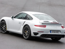 2014-Porsche-911-Turbo-Coupe-Rear-Quarter-6-1500x1000.jpg