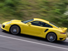 2014-Porsche-911-Turbo-Coupe-Side-1500x1000.jpg