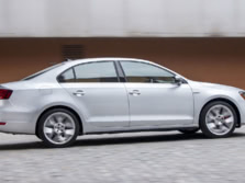 2014-Volkswagen-Jetta-GLI-Sedan-Side-2-1500x1000.jpg