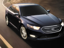 2015-Ford-Taurus-Sedan-Front-Quarter-4-1500x1000.jpg