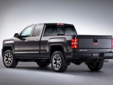 2015-GMC-Sierra-1500-Rear-Quarter-1500x1000.jpg