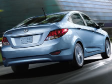 2014-Hyundai-Accent-Rear-Quarter-1500x1000.jpg