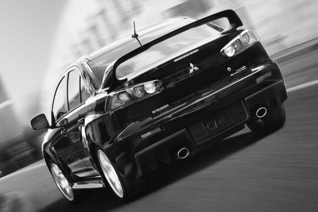 2014-Mitsubishi-Lancer-Evolution-Rear-Quarter-2-1500x1000.jpg